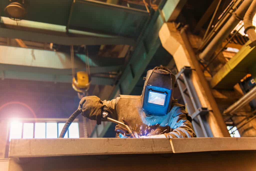 worker fixing critical manufacturing asset