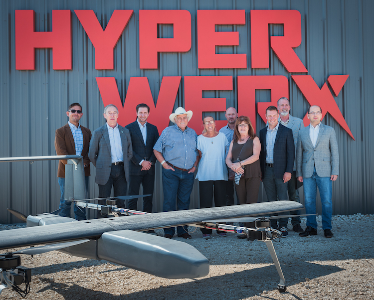 Rep. Carter, Mayor Condon, Florence Chamber of Commerce President Peggy Morse, and Chamber member Ben Daniel posing outside HyperWerx facility with SparkCognition's X2 UAV displayed.